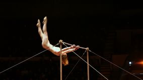 Acrobats perform exercises on the bar in the circus arena.  stock footage