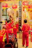 Acrobats are performing a lion and dragon dance Stock Image