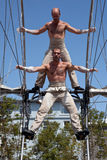 Acrobats performs in the square. GALWAY, IRELAND - JULY 13: French acrobats and circus artists Les Philbulistes M.Bourdon and S.Bruas performs at annual Galway Stock Photo