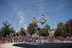 Acrobats performs in the square. GALWAY, IRELAND - JULY 14: French acrobats and circus artists Les Philbulistes M.Bourdon and S.Bruas performs at annual Galway Stock Photography