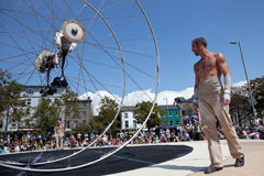 Acrobats performs in the square. GALWAY, IRELAND - JULY 13: French acrobats and circus artists Les Philbulistes M.Bourdon and S.Bruas performs at annual Galway Royalty Free Stock Photography