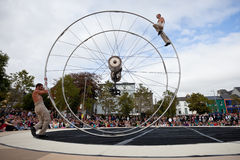 Acrobats performs in the square. GALWAY, IRELAND - JULY 14: French acrobats and circus artists Les Philbulistes M.Bourdon and S.Bruas performs at annual Galway Stock Images