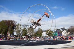 Acrobats performs in the square. GALWAY, IRELAND - JULY 14: French acrobats and circus artists Les Philbulistes M.Bourdon and S.Bruas performs at annual Galway Royalty Free Stock Photos