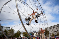 Acrobats performs in the square. GALWAY, IRELAND - JULY 14: French acrobats and circus artists Les Philbulistes M.Bourdon and S.Bruas performs at annual Galway Stock Image