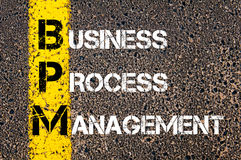 Acronym BPM - Business Process Management. Business Conceptual image with yellow paint line on the road over asphalt stone background royalty free stock photos
