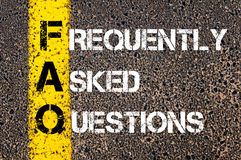 Acronym FAQ - Frequently Asked Questions. Business Conceptual image with yellow paint line on the road over asphalt stone background stock photo