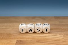 The acronym `FAST`. Is used as mnemonic to help a person having a stroke. `FAST` stands for `facial drooping`, `arm weakness`, `speech difficulties` and `time stock photography
