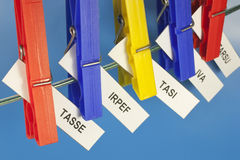 Acronyms taxes. Various acronyms taxes from tight clothespins Royalty Free Stock Photo