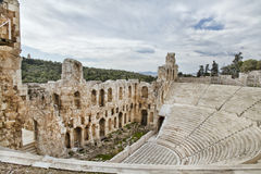 Acropolis of Athens. Remains of Odeon of Herodes Atticus. Remains of Odeon of Herodes Atticus  near the Acropolis of Athens. In the background could see Lombardy Royalty Free Stock Photos