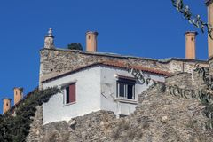 The Architecture of Kavala - Detail. House over part of the fortress wall. Greece. stock photography