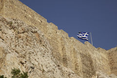 Acropolis Greek Flag. Greek flag flying on the acropolis. Athens, Greece Royalty Free Stock Photo