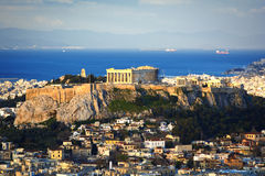 Acropolis hill and Plaka. View of the Acropolis of Athens and the Plaka area in the morning. Saronic gulf at the background Royalty Free Stock Photos