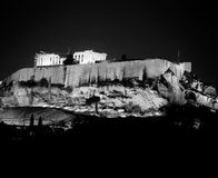 Acropolis Illuminated At Night. A view of the Acropolis in Athens at midnight. The hilltop and the Acropolis are brightly illuminated.  (Scanned from black and Stock Photos