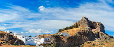 Acropolis of Lindos bottom view of the bay of Rhodes Greece summ. Acropolis of Lindos bottom view of bay of Rhodes Greece summer sunny weather with clouds Royalty Free Stock Images