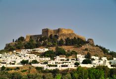 Acropolis of Lindos and city with white houses. Rhodes island, Greece. Clear summer day stock image