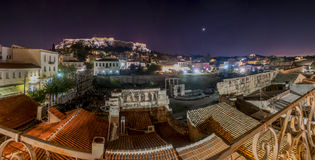 Acropolis by night panorama. Plaka and roman agora view Stock Photography