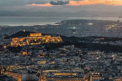 The Acropolis with the Parthenon Temple over the old town down to Pireas Port stock photos
