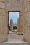 Acropolis propylaia ancient columns. View to the city of Athens Greece from the Acropolis Propylaia. Ancient columns and gate Royalty Free Stock Images