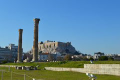 Acropolis seen from Temple of Zeus in Athens. Temple of the Olympian Zeus at Athens and park Royalty Free Stock Image