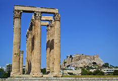 Acropolis and temple of Olympian Zeus Athens Greece. Acropolis view behind the temple of Olympian Zeus in Athens Greece Royalty Free Stock Images