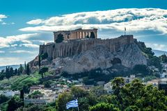 Acropolis view from behind under blue sky Royalty Free Stock Image