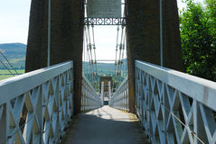 Across the chain bridge at Melrose Royalty Free Stock Photo