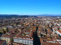 Across the city of florence. Across the roof tops of the historical city of florence. under a deep blue skt with the tuscany hills in the background Stock Images