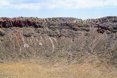 Across the Crater. The landscape of the Arizona desert was changed forever when a meteor from outer space crashed into the ground and created a crater almost a stock photo