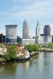 Across The Cuyahoga. A vintage tugboat built during World War 2 is moored on the bank of the Cuyahoga River with downtown Cleveland, Ohio in the background royalty free stock images