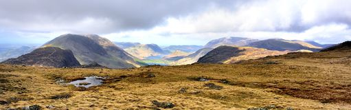 Across Haystacks to cloud covered Buttermere Fells. Sunlight on the Buttermere valley Stock Photo