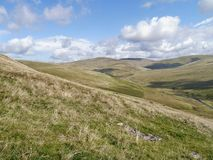 Across hillside to hills, River Calder down right. Enticing view across hillside more and more hills ahead with the River Calder down on the right stock images
