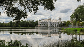 Across Lake Bohemian Hotel Celebration Florida. View of the Bohemian Hotel from across the lake with reflection in the water of closed and framed by trees royalty free stock photo