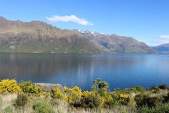 Across Lake Wakatipu to Bayonet Peaks, New Zealand. View north west across the southern arm of Lake Wakatipu from state highway 6 in Otago, South Island, New stock photography