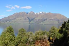 Across Lake Wakatipu to Cecil Peak, New Zealand. VIew west from Drift Bay across the southern arm of Lake Wakatipu to Cecil Peak, Otago, South Island, New royalty free stock image