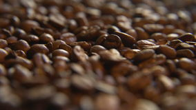 Across a Pile of Coffee Beans. Macro close up moving through lush a pile of roasted coffee beans stock footage