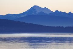 Mount Baker across the Puget Sound in the blue hour. Across the Puget Sound at dawn Mount Baker, Washington, USA, rears above the foothills waiting for sunrise Royalty Free Stock Image