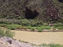 Across the Rio Grande is either a cave or an outcropping casting a shadow Royalty Free Stock Image