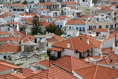 Across the rooftops. Looking across the rooftops of the town of Skopelos in the Greek island group of the Northern Sporades stock photo