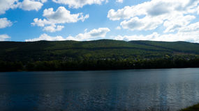 Across the Shore. A sweeping picture capturing the mountains and some of the town found across the Susquehanna river Stock Images