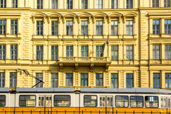 Across town. Matching yellow tramway and building in Budapest, Hungary royalty free stock images