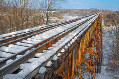 Across the Tulip Trestle. Built in 1905, Indiana's Tulip Trestle or Greene County Viaduct is one o fthe world's longest railroad bridges and is covered with snow Royalty Free Stock Photography