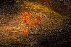 Acrosss Verbreitung des roten Pfeffers eine Holzoberfläche Stockbilder