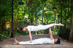 Acroyoga in the garden Stock Photography