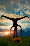 Acroyoga girl of male in romantic atmosphere Royalty Free Stock Images