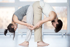 Acroyoga, Standing Half Forward Bend pose Stock Photos
