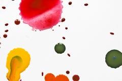Acrylfarbe plätschert und Stellen für Hintergrund Stockbilder