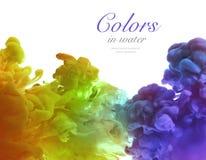 Acrylfarben und Tinte im Wasser Entziehen Sie Feldhintergrund Stockbild