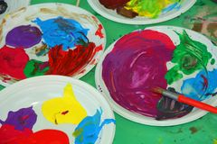 Acrylic color palettes. To the nursery during the drawing lesson stock photography