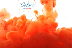 Acrylic colors and ink in water. Stock Images