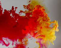 Acrylic colors and ink in water. Royalty Free Stock Images